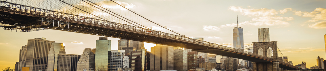 The setting sun shines behind a cityscape in this Banner image for Certification Resource Center