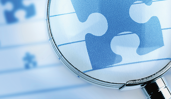 Puzzle pieces under a magnifying glass as Link image for ISO 9001:2015 Foundation and Internal Auditor training course